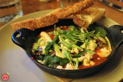 Shakshuka Egg Cast Iron Skillet (spiced tomato sauce, charred garlic yogurt, herb chutney, feta chee