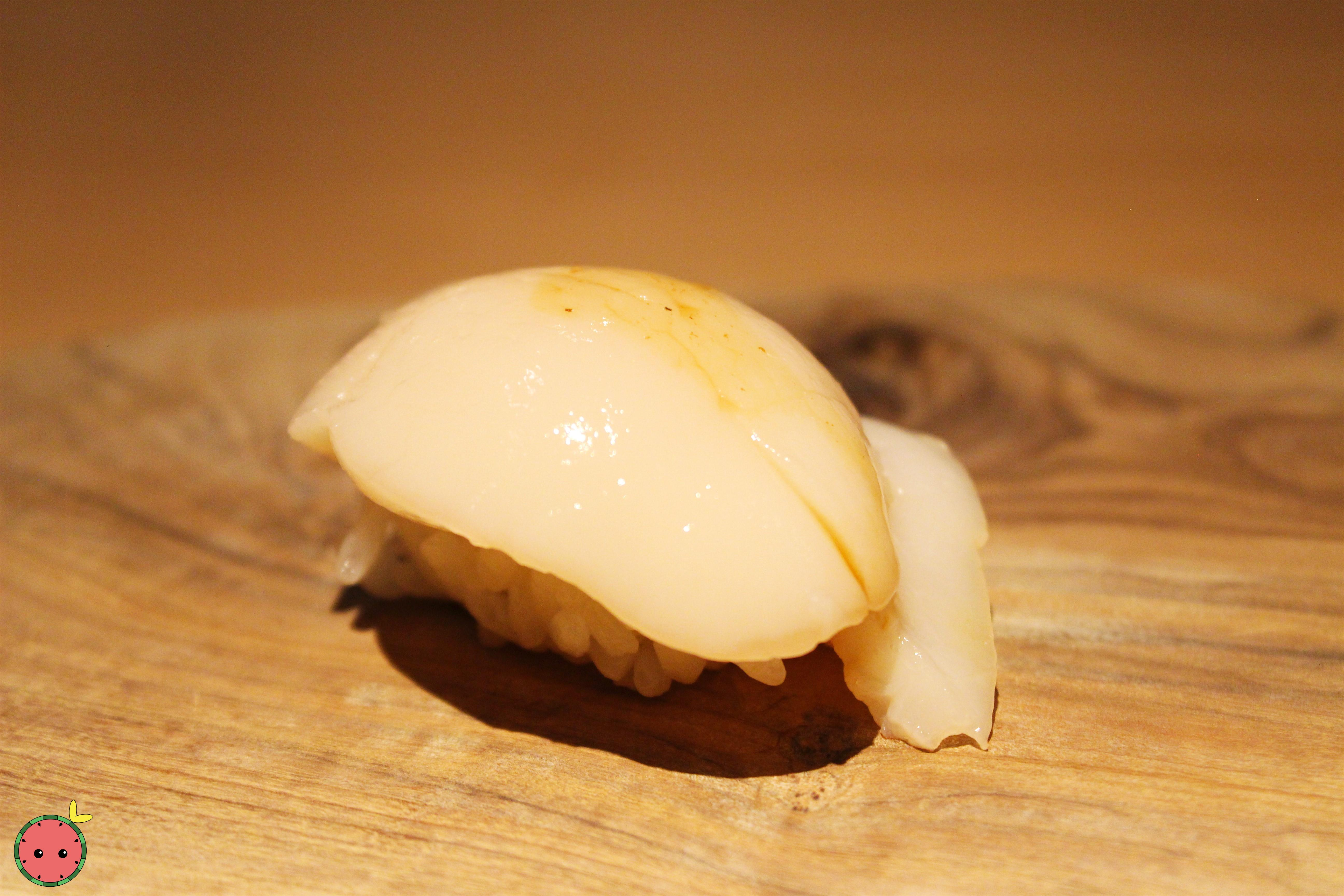 Live scallop from Boston with orange soy sauce