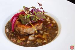 Braised and roasted suckling pig with stewed lentils