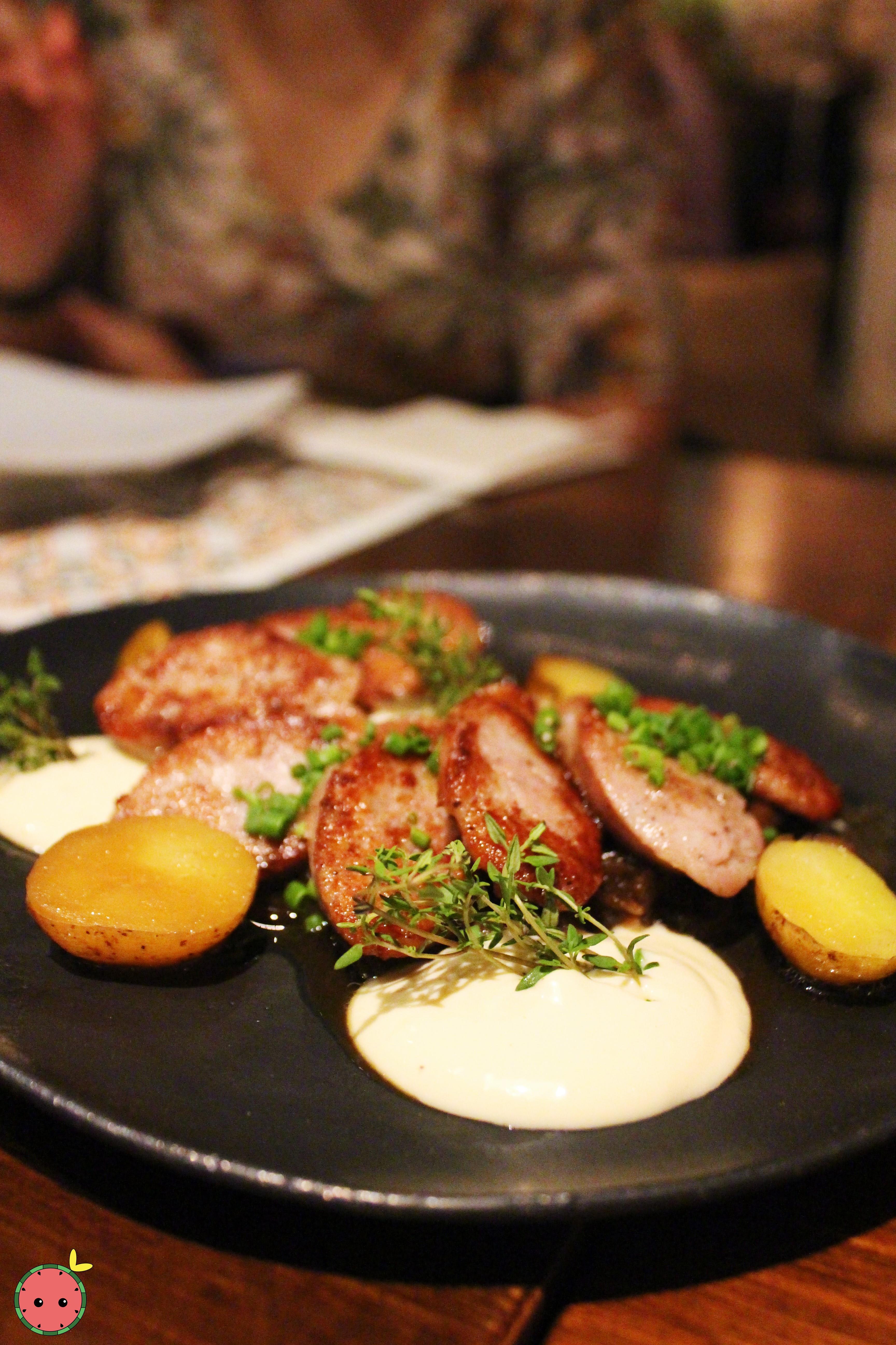 Botifarra Catalana - Catalan sausage with marbled potatoes, caramelized onions,  & shitake mushrooms