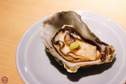 Kumamoto oyster from California with fresh citrus and wasabi