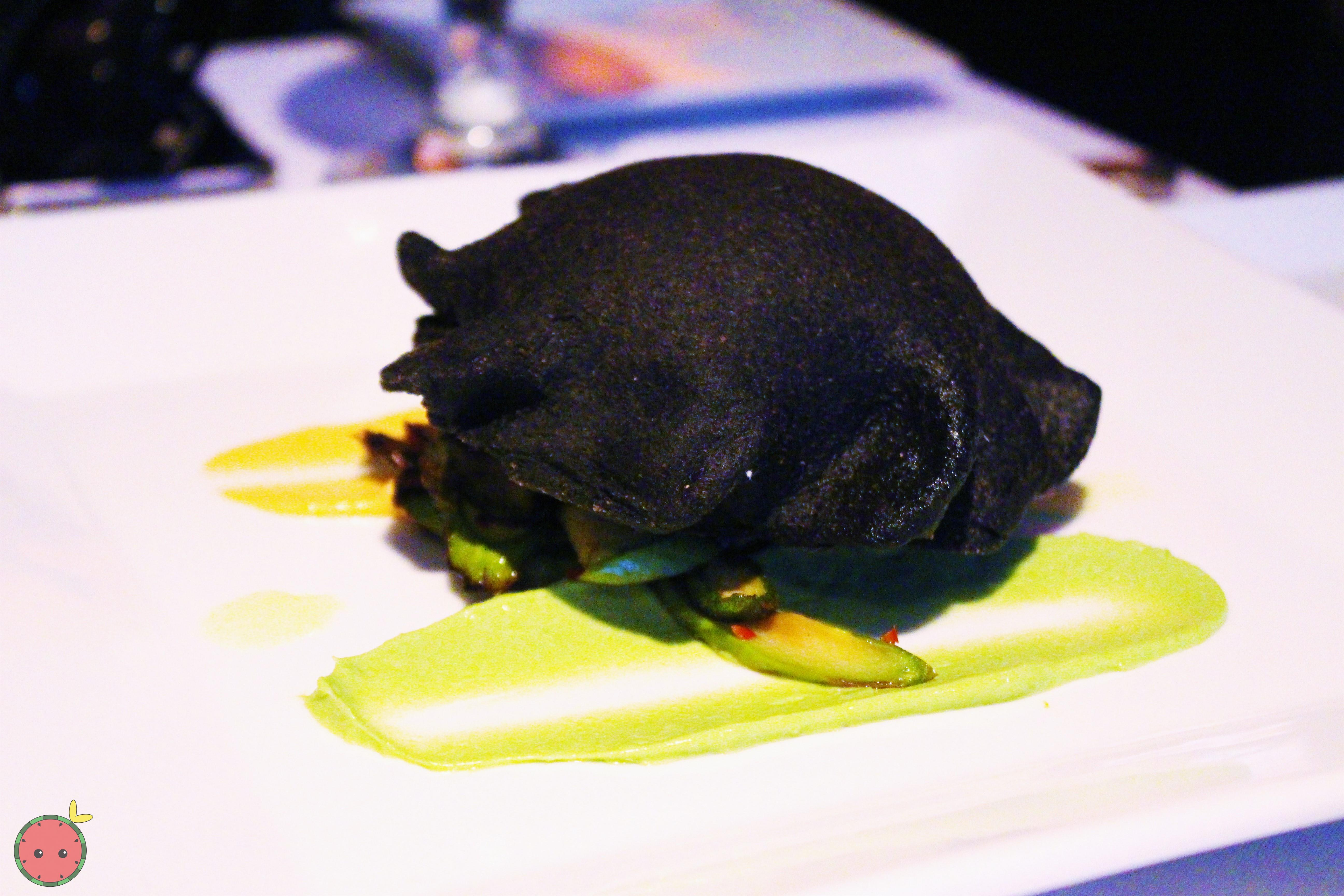 Lobster Empanada - Squid ink dough filled with Maine lobster and butter with avocado sauce and salsa