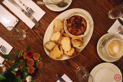 Hot artichoke dip with crisp bread