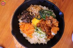 Spicy Pork Bibim-Bap - Traditional korean rice dish with pork, marinated vegetables, jidori fried eg