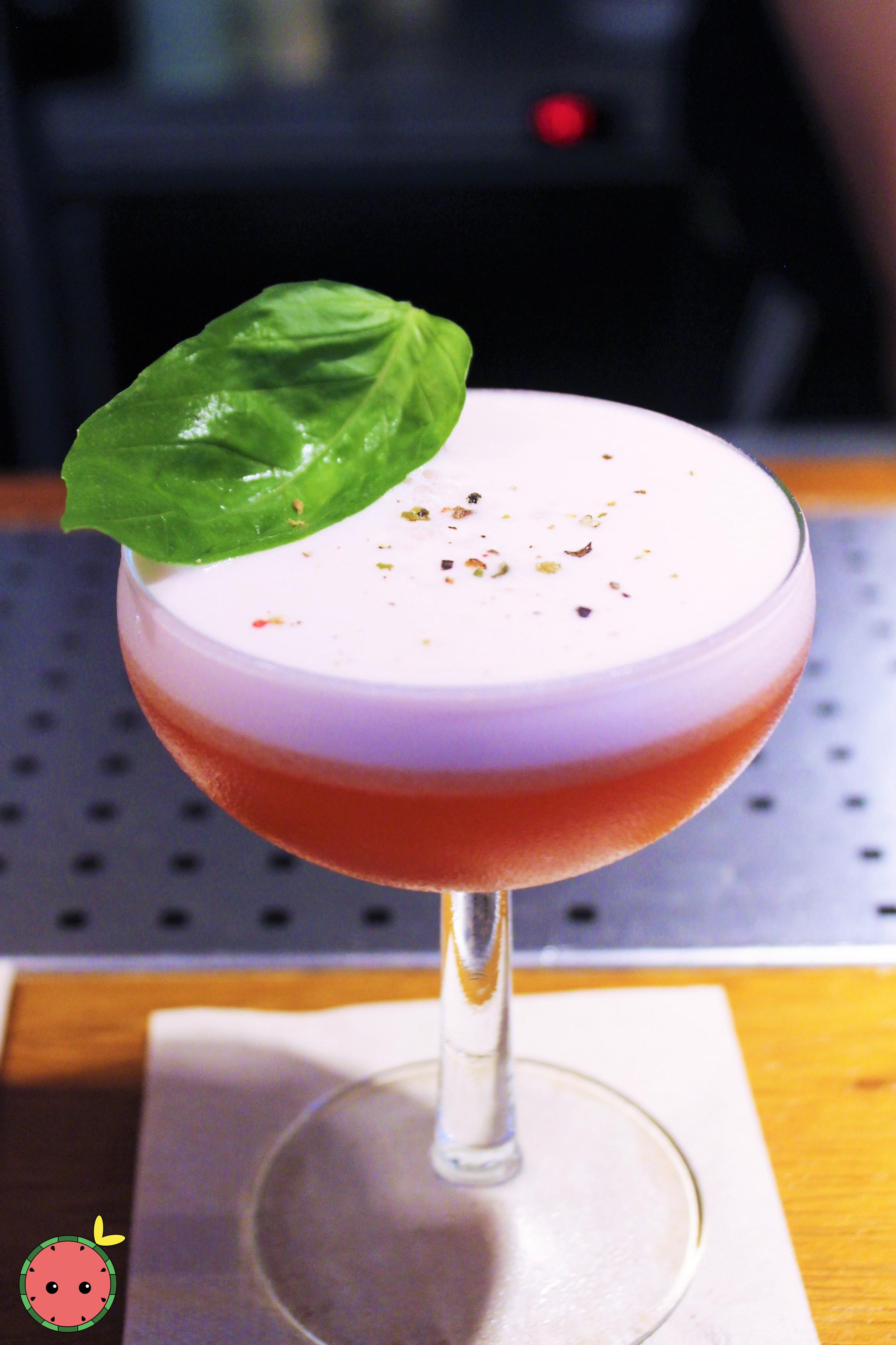 Basil Club Cocktail - Gin sour, raspberries, basil, and fresh lemon juice topped with ground pepper