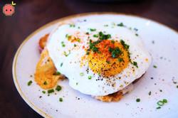 Porchetta with Aged Provolone, Broccoli Rabe, Calabrian Chile, & Sunny Egg