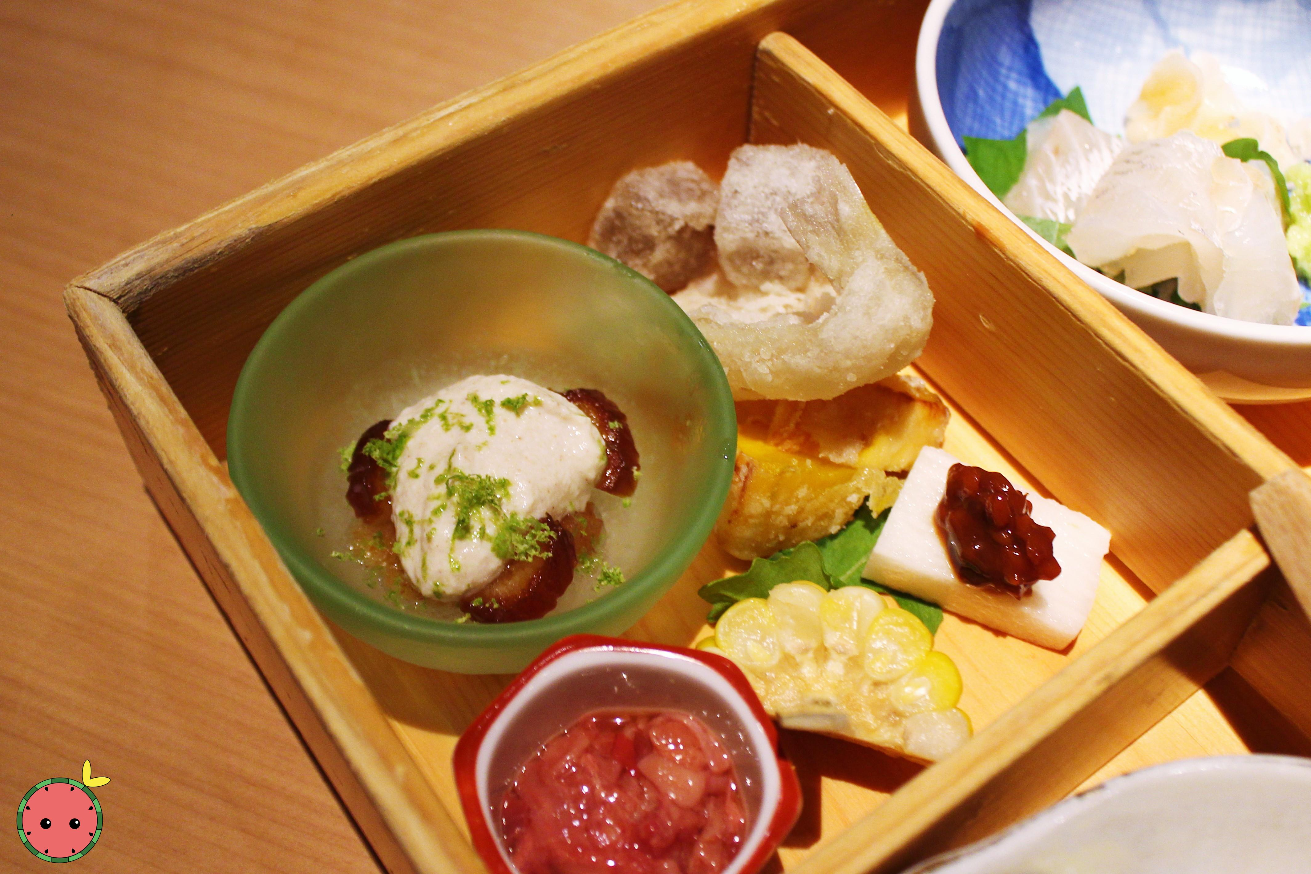 Bento Box - Sesame tofu with organic dates and sapodilla with lime zest; fried kisu and konyaku; mou