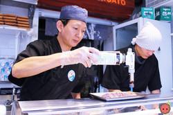 Sushi chef blow torching the wagyu (2)
