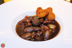 En Meurette with bacon and mushrooms in red wine reduction