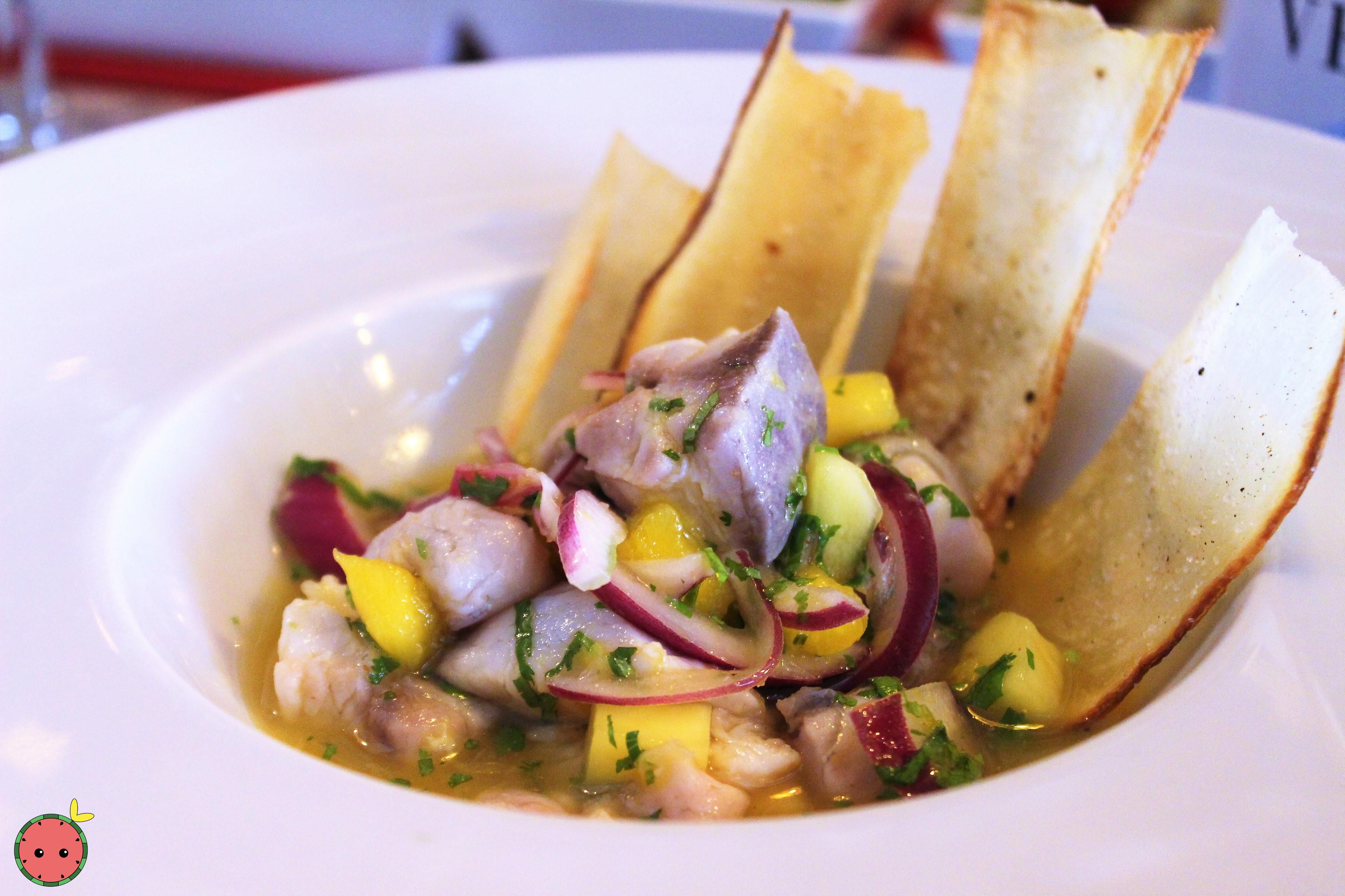 Our special ceviche with yucca chips