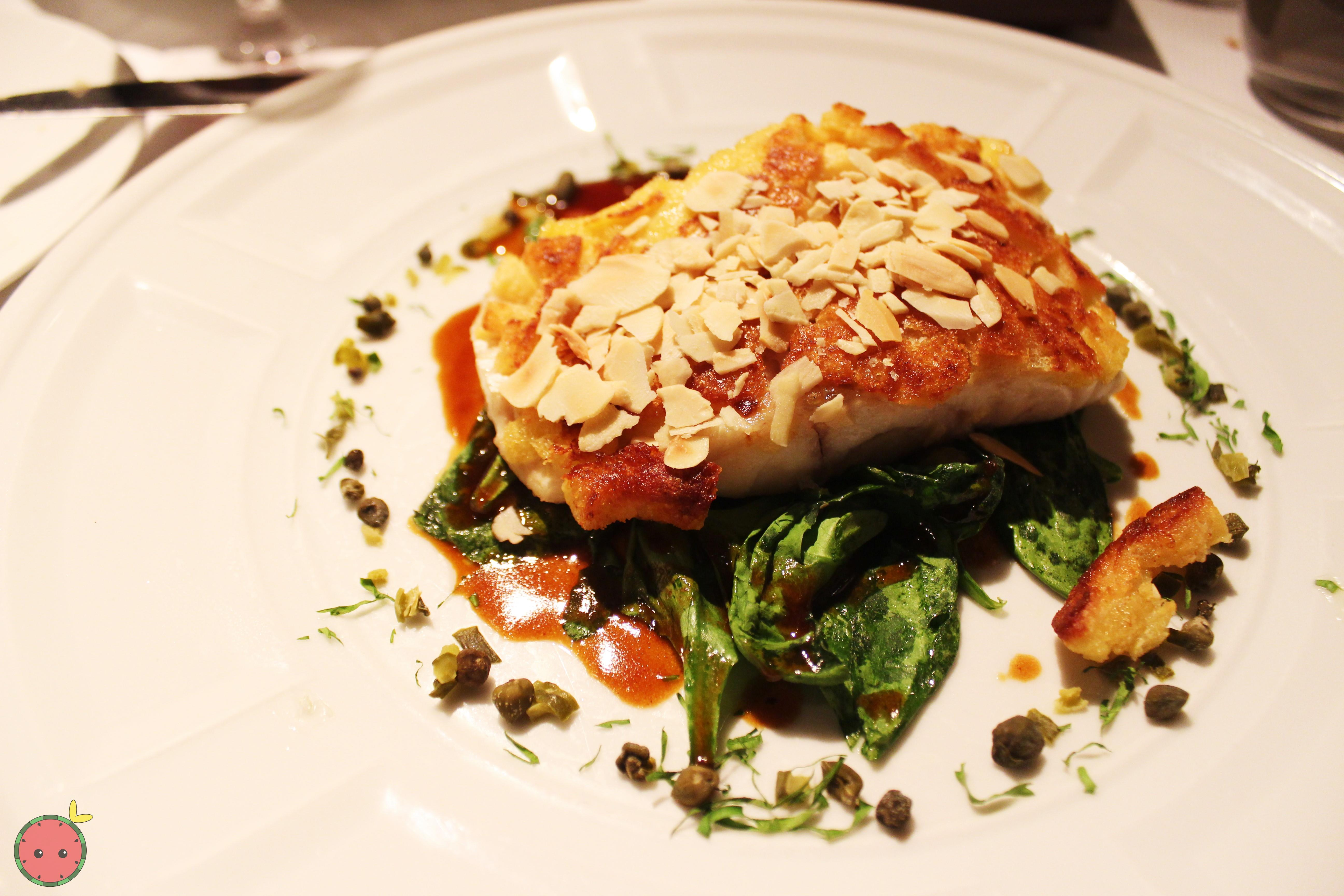 Crusty sea bass with almonds, lemon, and caper vinaigrette