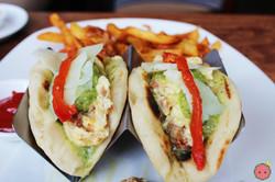 Laffa Taco - Scrambeled eggs with chorizo, machego cheese, salsa verde, spicy garlic fries