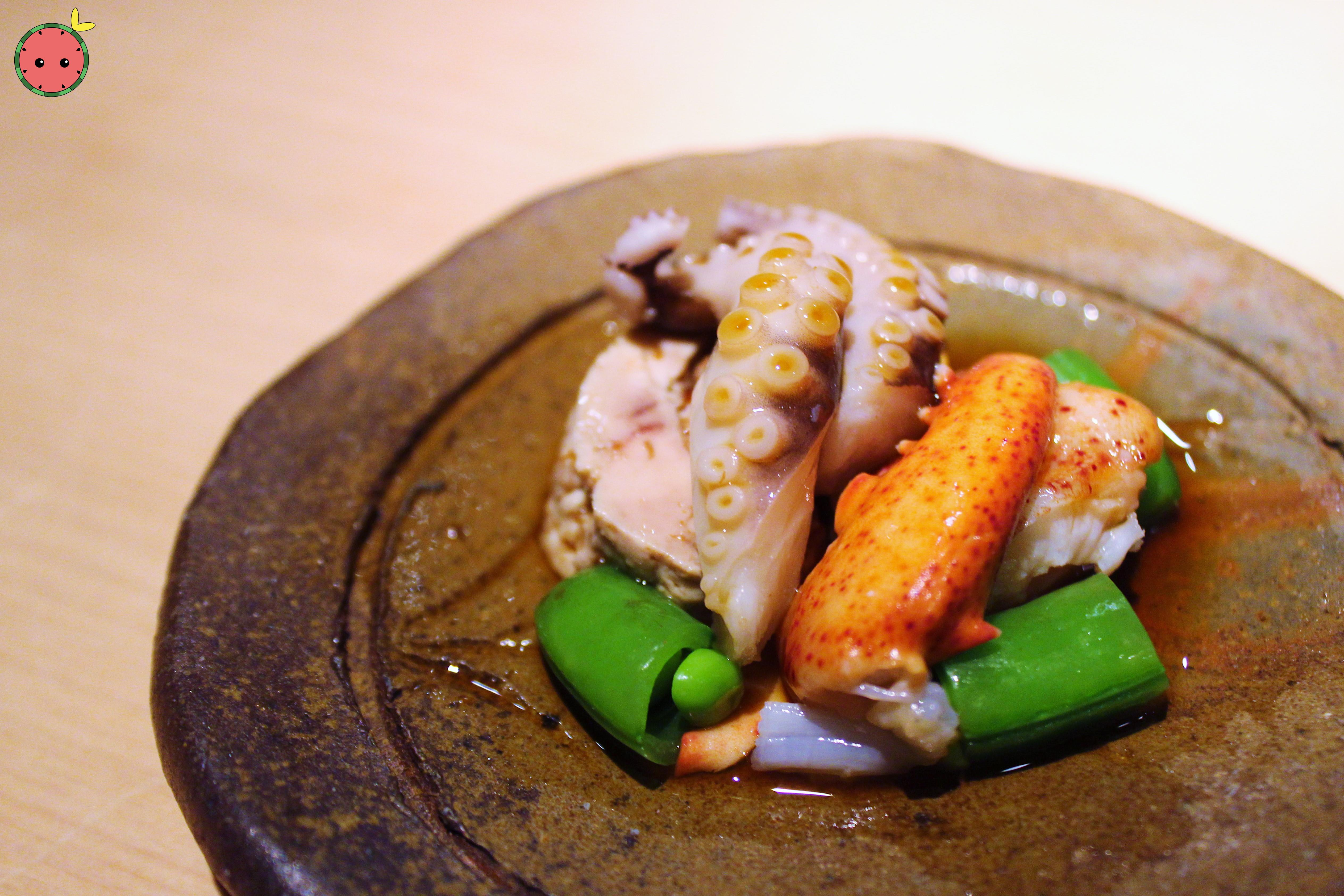 Lightly poached Main lobster, octopus from Portugal, steamed monk fish liver, sugar snap peas with c