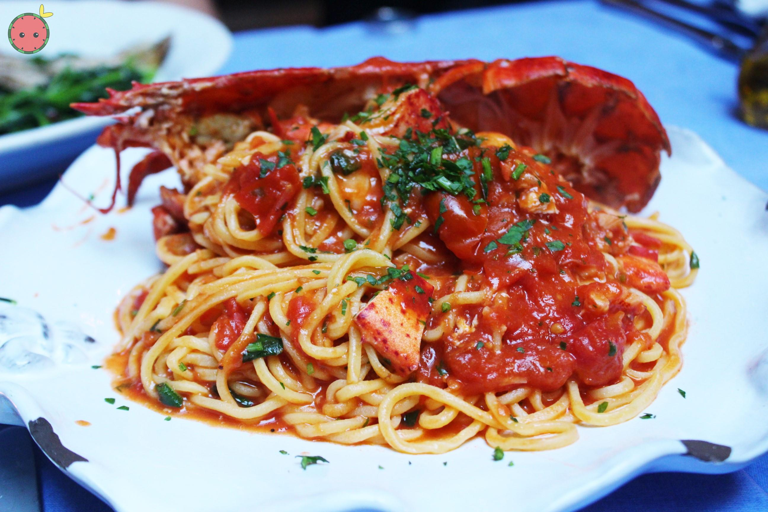 Spaghetti all'Astice - Half Maine lobster with homemade spaghetti in a sauce of lobster, cherry toma