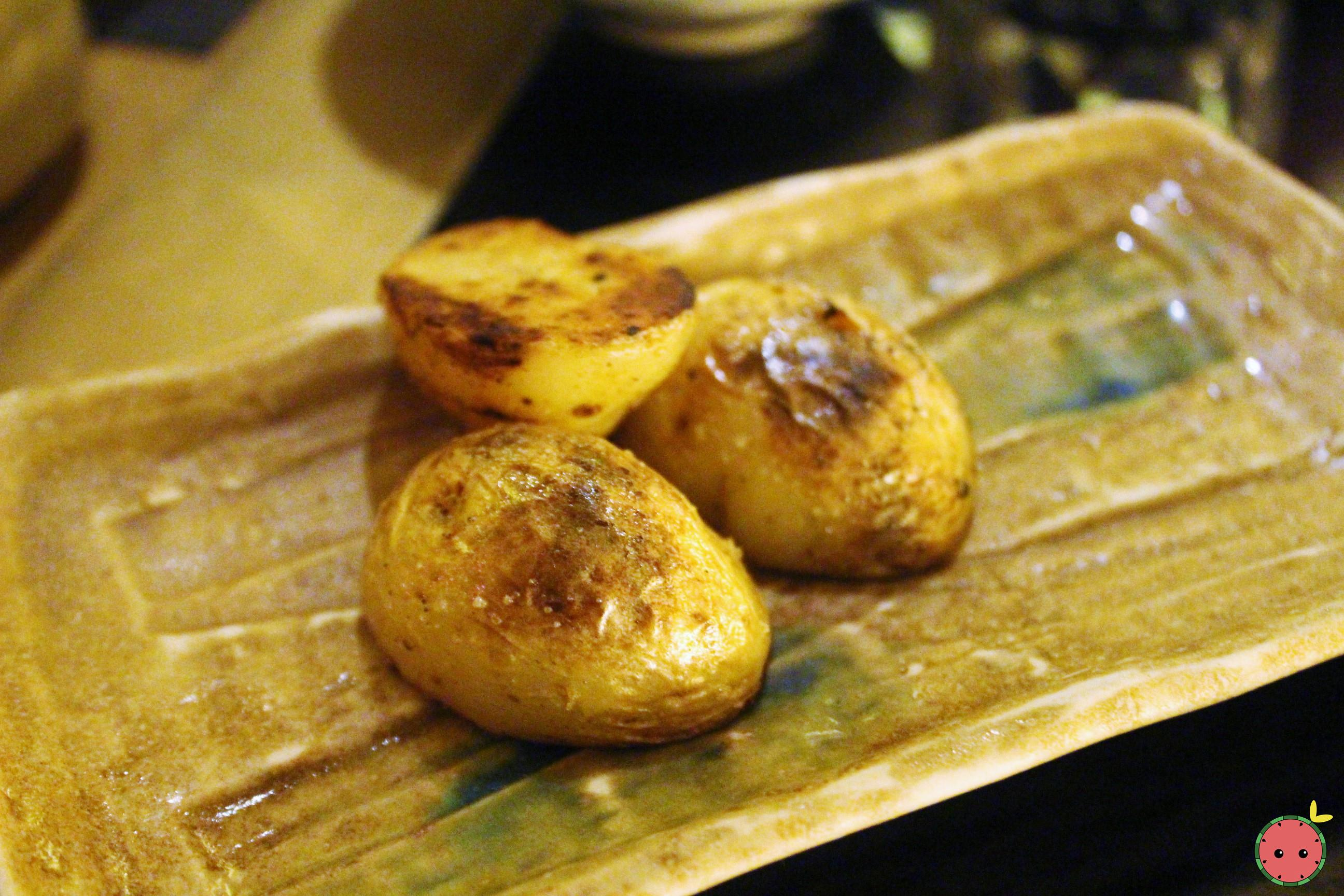 Grilled and buttered potato