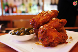 Spicy Korean fire chicken wings with honey, garlic, four chilies, and peanuts