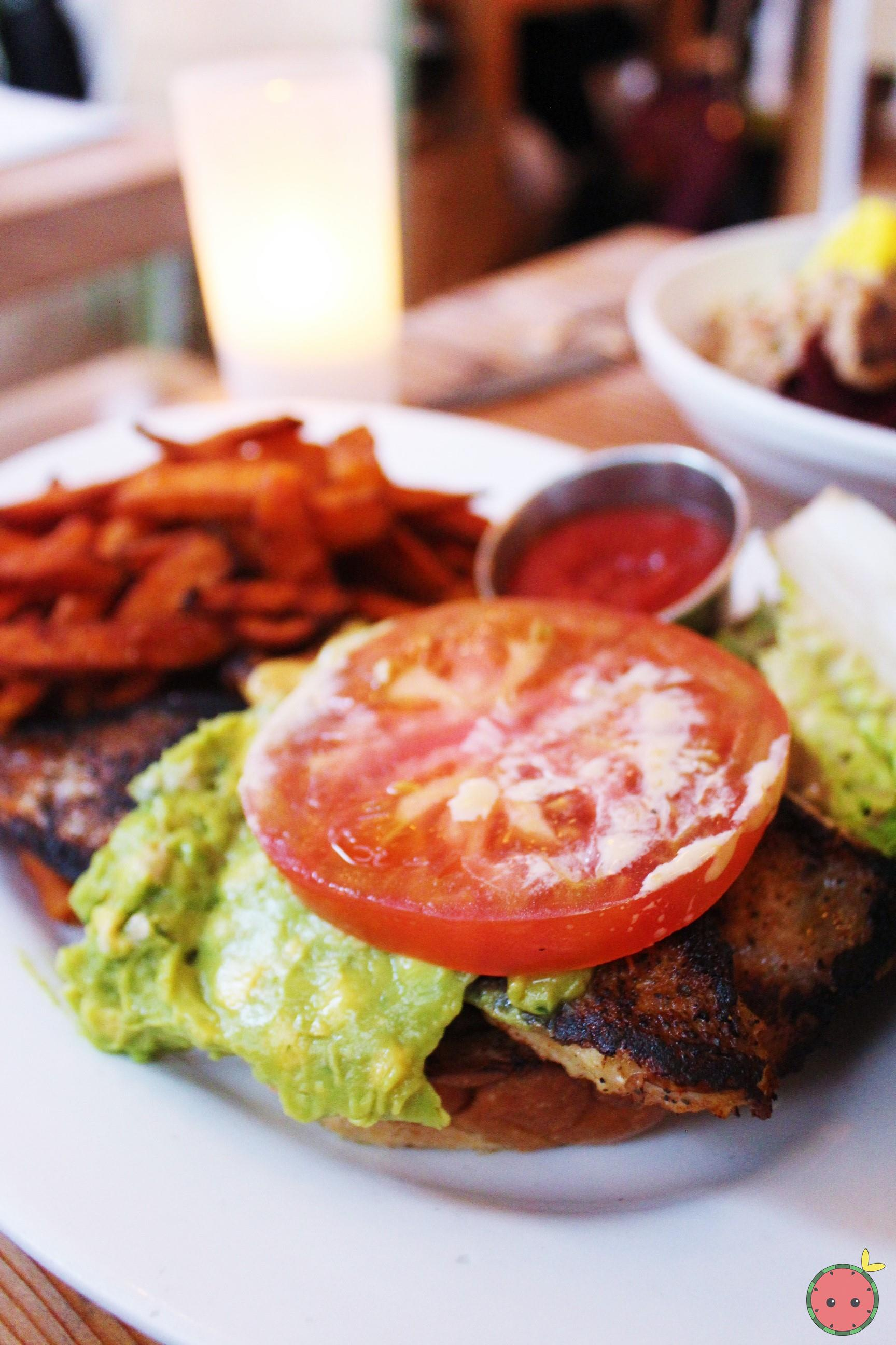 Blackened catfish sandwich with avocado, citrus aioli, lettuce, tomato, and sweet potato fries