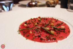 Yellow-fin tuna carpaccio with Iberico ham chutney, sea beans, lemon-extra virgin olive oil