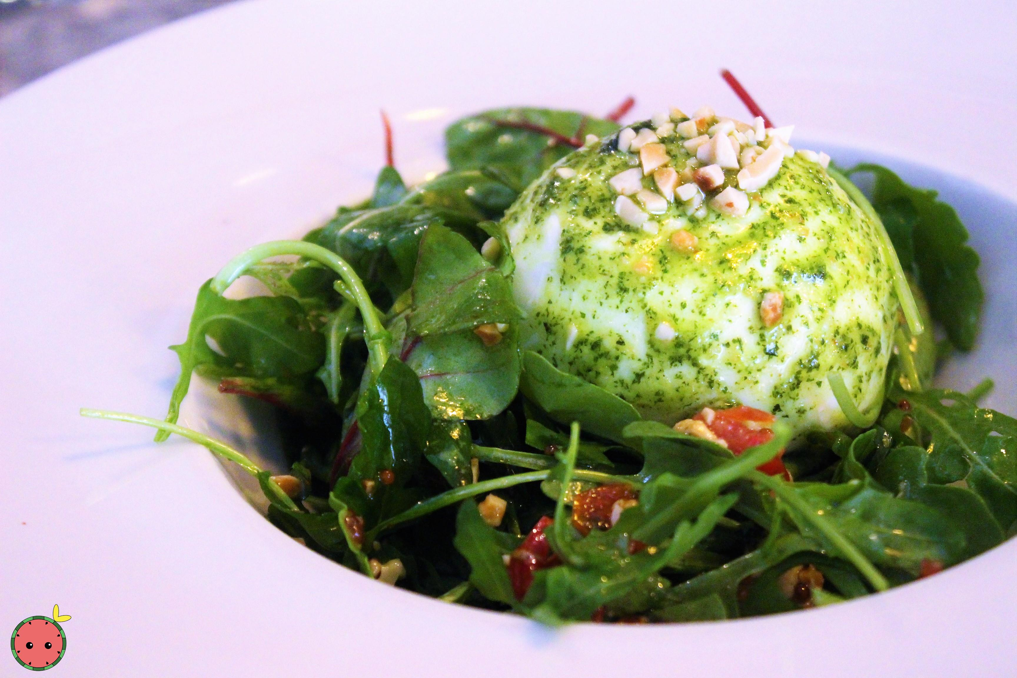Buffalo Burrata, rocket salad (arugala), sun-dried tomatoes and nuts with basil pesto