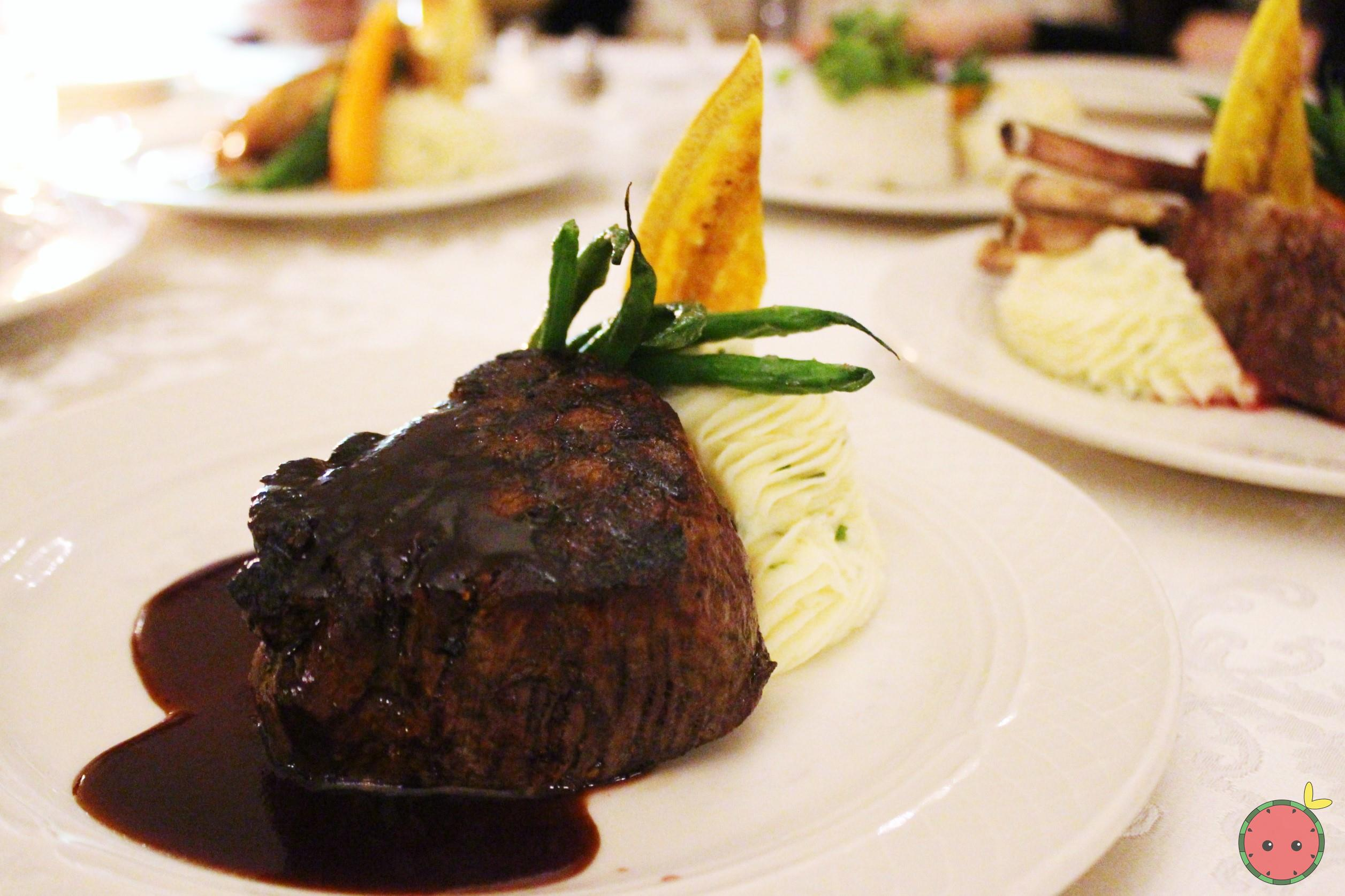 Grilled sterling silver filet mignon (port wine demi-glace) with caramelized garlic mashed potatoes,