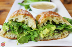 Avocado Smash Farm Style Sandwich - Roasted mushrooms, arugula, chili flakes, garlic, and lemon
