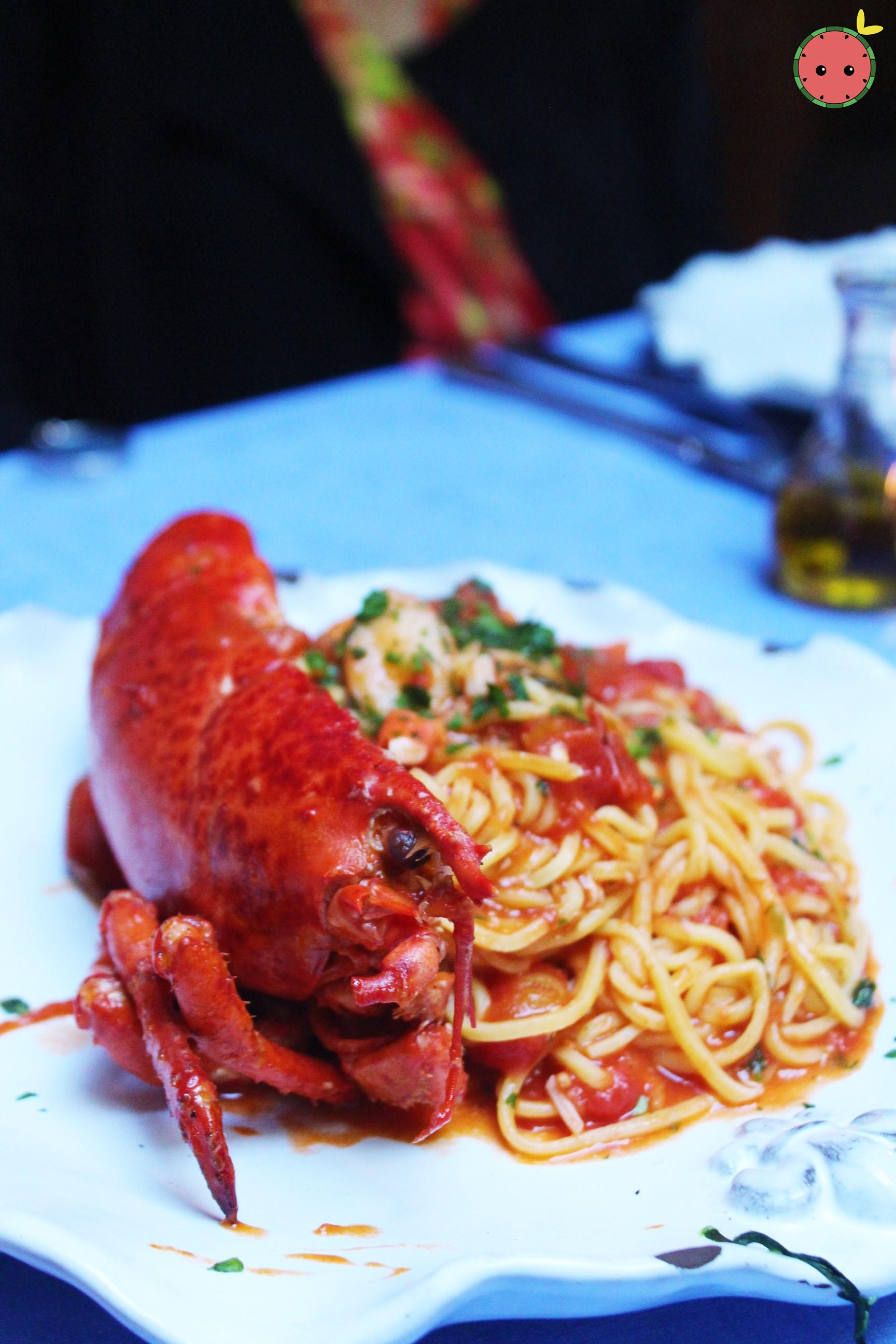 Spaghetti all'Astice 2 - Half Maine lobster with homemade spaghetti in a sauce of lobster, cherry to