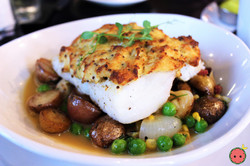 Crab Crusted Cod with Slab Pancetta, Roasted Onions, Marble Potato Succotash, & Tarragon Butter