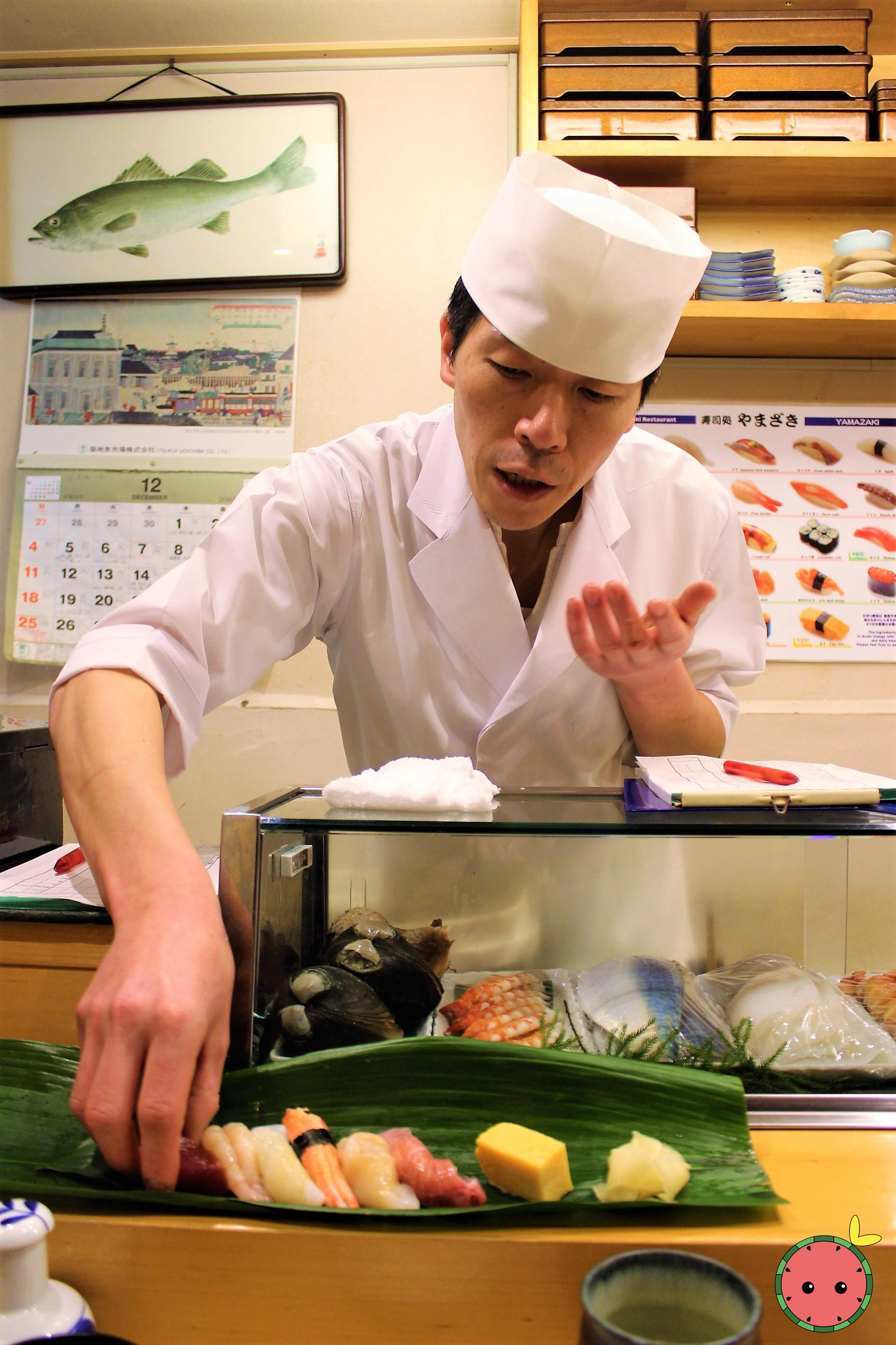 Chef placing sushi