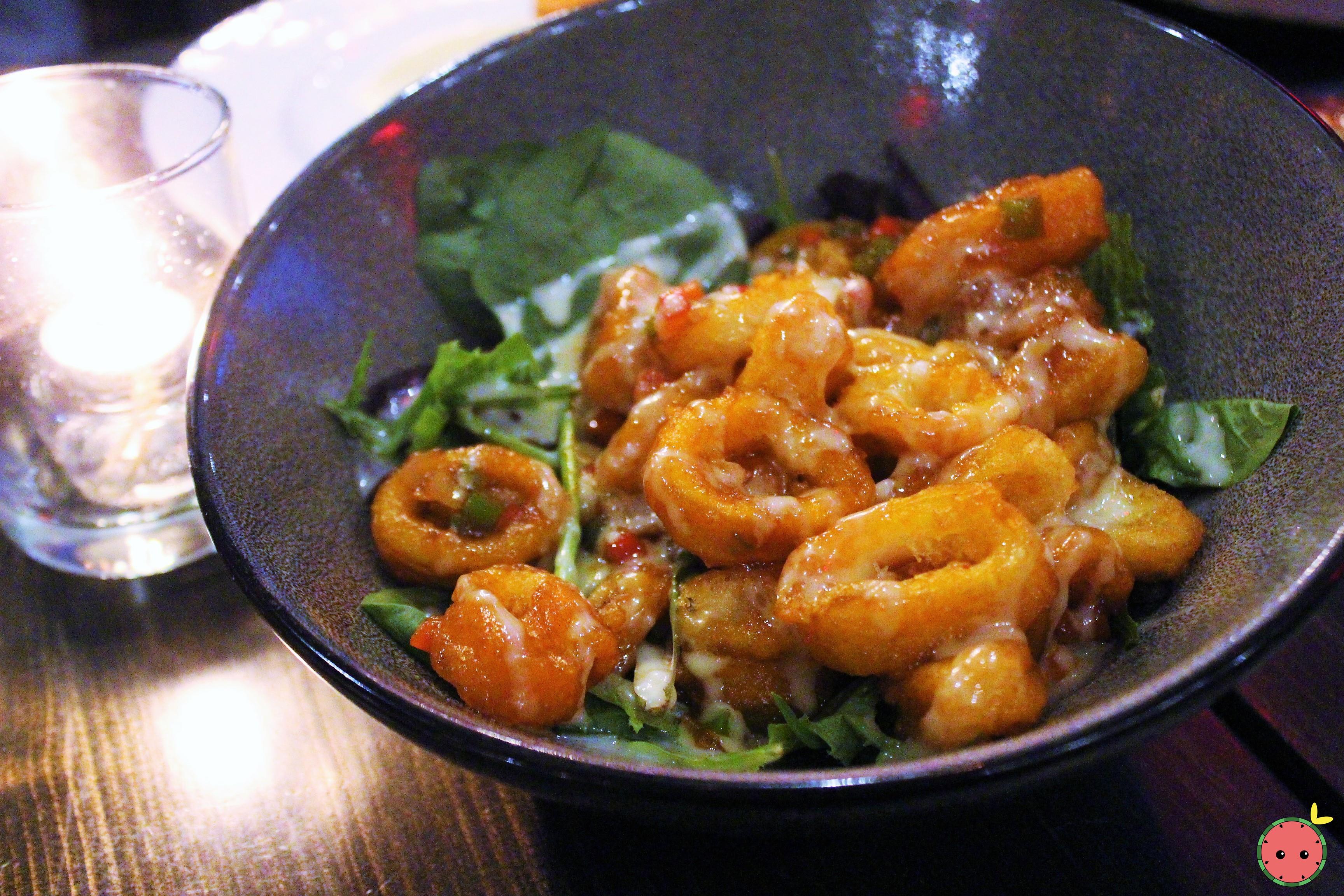 Calamari Salad - Fried calamari, spicy sauce, sweet mayo, mesclun salad