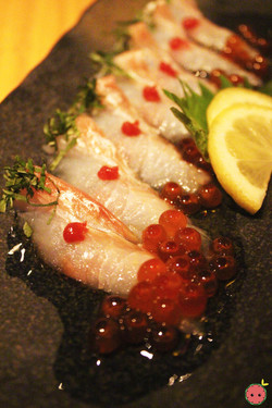 Fluke Carpaccio - Thinly sliced fluke sashimi drizzled with olive oil topped with plum paste