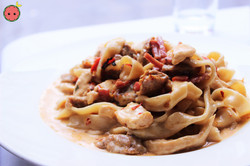 Crazy Alfredo Fettuccine with Chicken, Sausage, & Sweet Roasted Peppers in a Spicy Alfredo Sauce