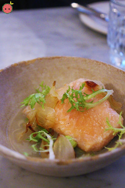 Citrus-cured trout with spring onion broth and red fava beans