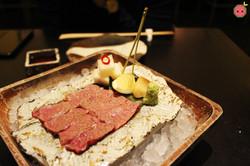 Washu-beef short rib sashimi with sweet daikon pickle and soy sauce garlic