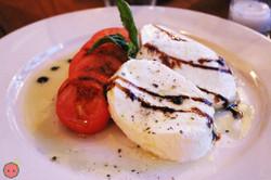 Caprese - tomatoes, fresh imported fior di latte mozzarella, basil, olive oil balsamic vinegar