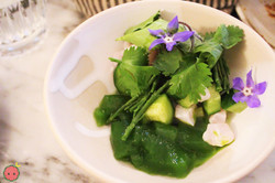 Dorade with baby cucumbers, citrus, pickled chilis, and herbs