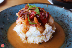Shrimp n' Grits - Seared shrimp, roasted tomatoes, Virginia ham, Nora Mill grits, PBR chicken jus