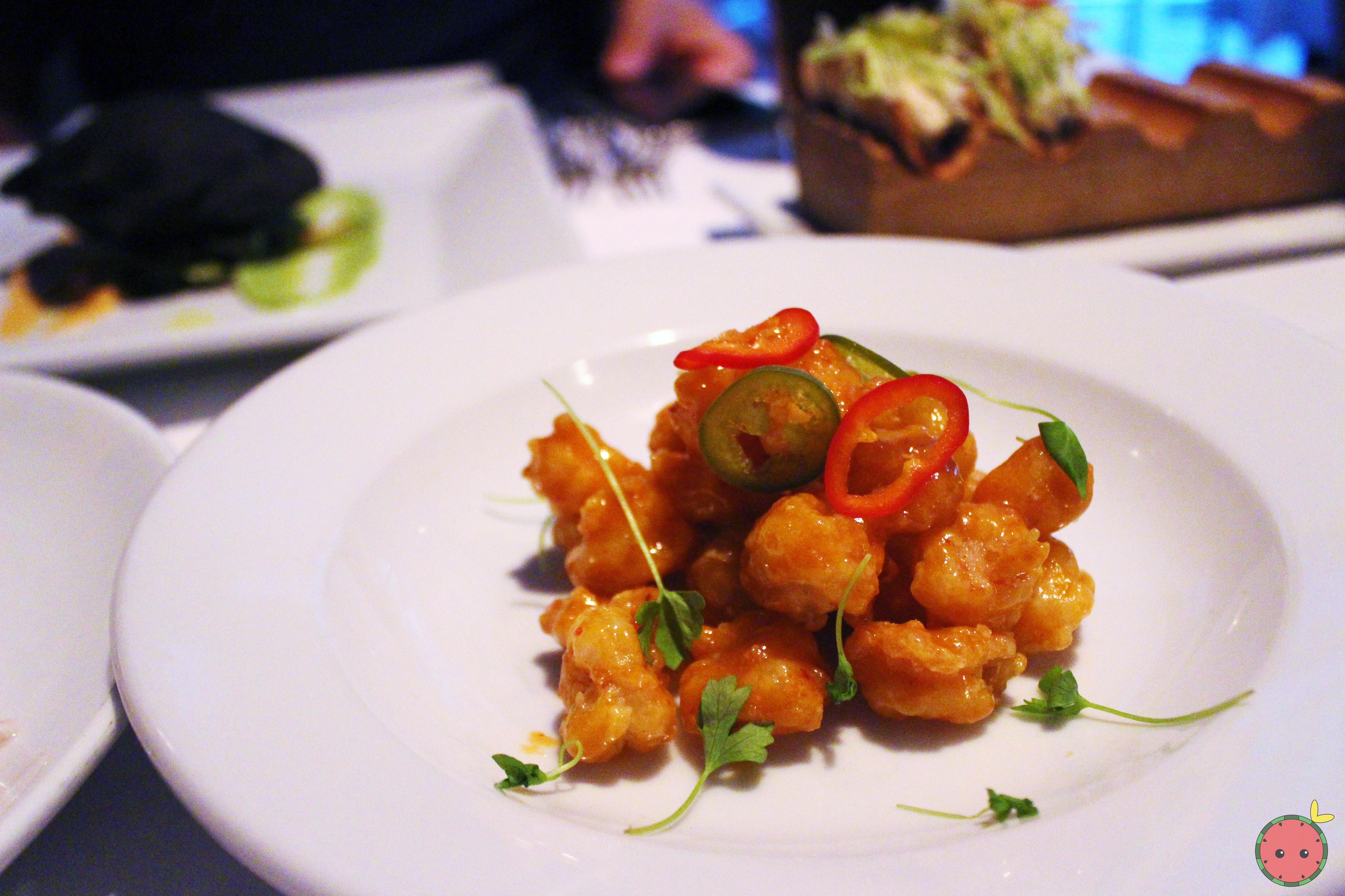 Chicharron - Crispy rock shrimp coated with rice and corn flour with a sweet and spicy panka sauce w