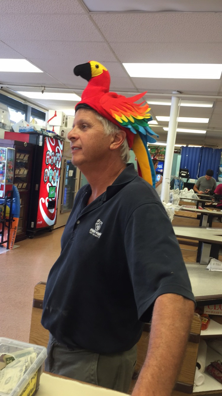 David, owner, rocking his parrot hat on wacky hat night
