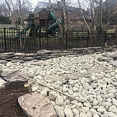 Creating waterfall and dry stream bed to control water runoff