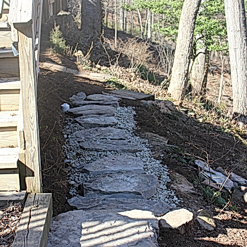 Flagstone path over infiltration trench