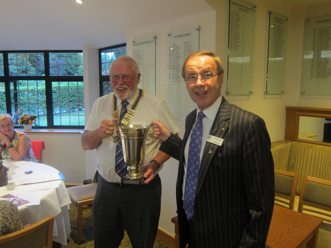 John Hannam receives the attendance cup