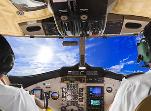 Pilots in the plane cockpit and cloudy s