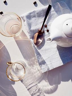whit-ceramic-teapot-on-towel-near-spoon-