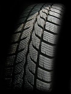 car tire in shadows