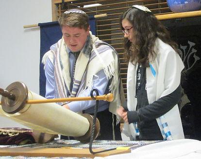 Our Rabbi reading torah with a Bat Mitzvah student