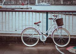 bicycle lean against metal fence
