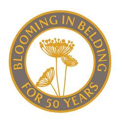 Blooming in Belding logo