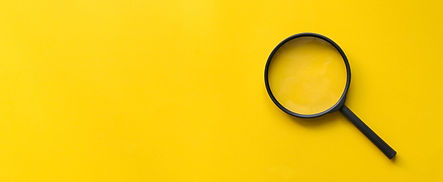 close-up-magnifier-glass-on-yellow-backg