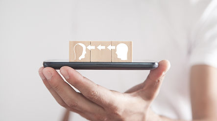 man-holding-smartphone-with-wooden-cubes