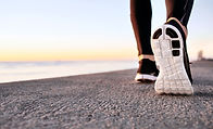closeup-of-sport-shoes-on-concrete-path.jpg